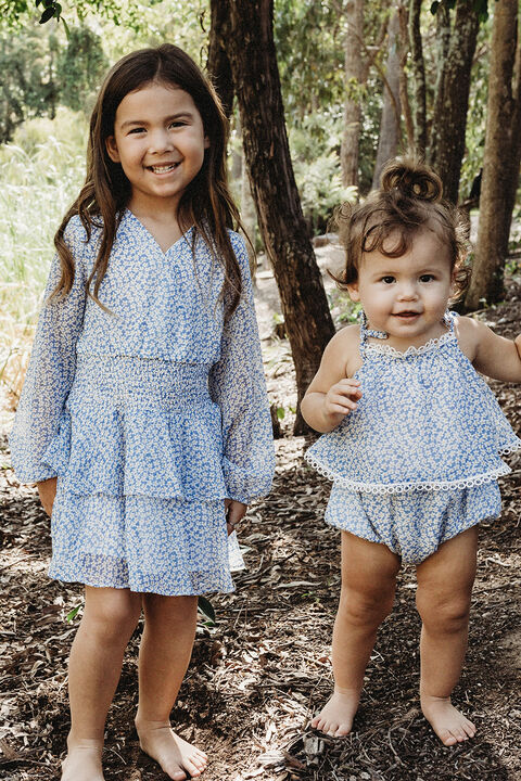 GIRLS DAISY SHIRRED DRESS  in colour POWDER BLUE